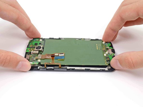 Gently lift the motherboard out of the phone, rotating it from the SIM slot edge of the phone.