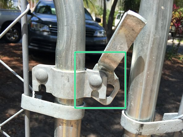 Insert a bolt and nut. Tighten to secure the latch.