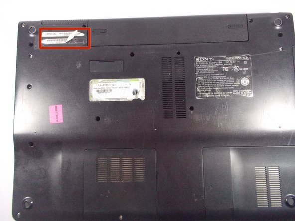 "Flip laptop over so that ""Service TAG"" is shown at the top left corner."