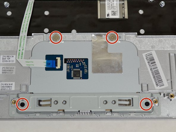 Remove all four 3.70mm screws around the edges of the touchpad using a Phillips #0 screwdriver.