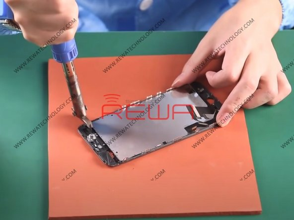 Take off the LCD screen from the phone, cut the 4 corners of the front bezel with Heating Soldering Iron. Stick adhesive tape on the whole glass lens to prevent the problems that may arise in subsequent operations.