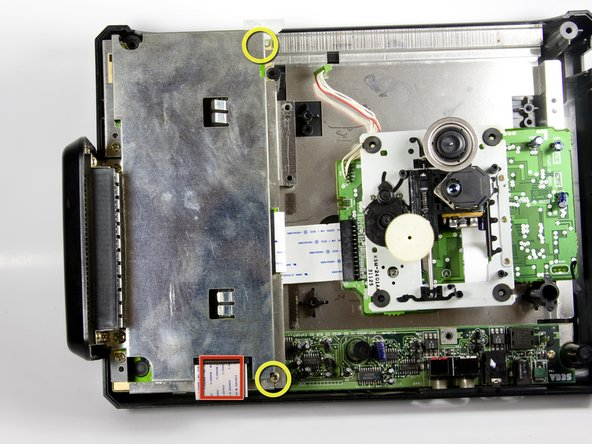 Image 1/3: Carefully lift the metal plate up to expose the motherboard.