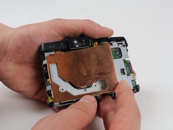 Image 1/2: Lift and remove the copper EMI shield.