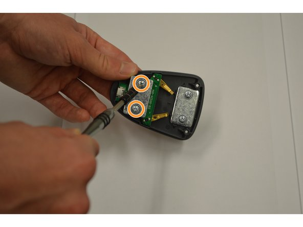Remove the two (4mm) screws using Phillips 1 screwdriver.