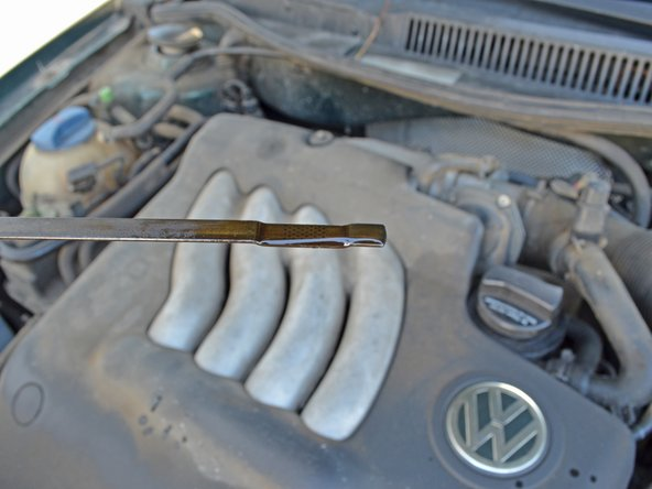 The bent length at the end of the dipstick marks the minimum and maximum oil levels. Check to make sure that you have the right amount of oil. It takes about one quart to go from minimum to maximum.