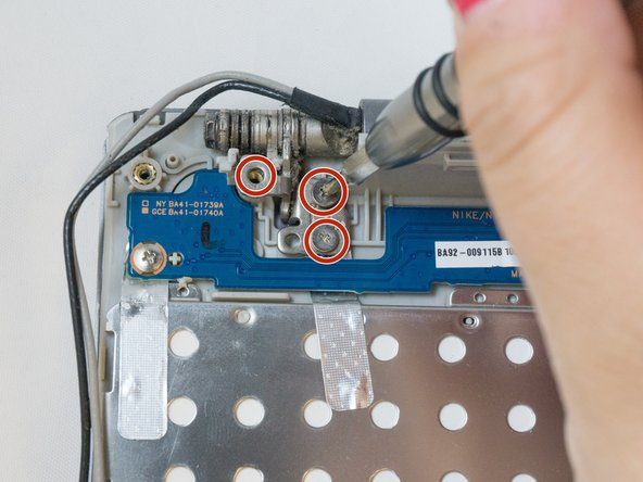 Using the Phillips#00, remove the six 4.5mm screws from the corner brackets holding the display to the inner case.