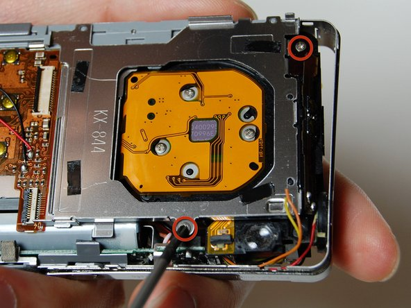 Image 1/2: Remove the frame on the back side of the camera where the LCD screen was.