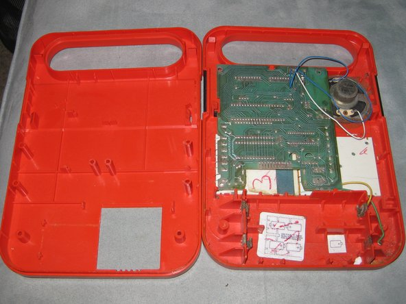 Separate the two halves of the case to expose the inner PCB, speaker and battery holder.