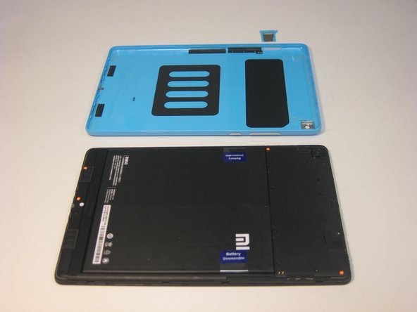 Image 2/2: The back panel has small clips and light adhesive that easily releases from the device.