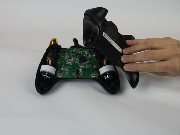Remove the back cover of the controller.