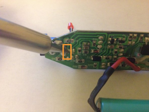 Place the negative leg of the LED through the negative hold in the printed circuit board and solder it into place.