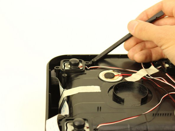 Use the nylon spudger to remove the charging assembly from the SmartBowl.