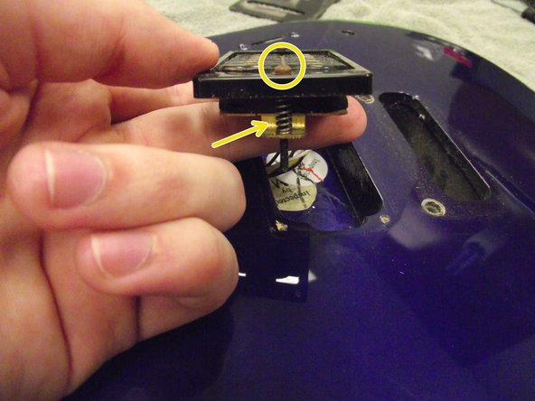 Gently pull the pickup out of the guitar body.
