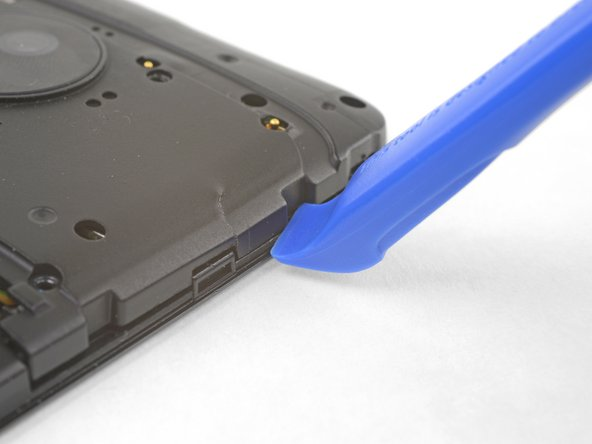 Insert an opening tool into the seam on the right side of the phone near the top.