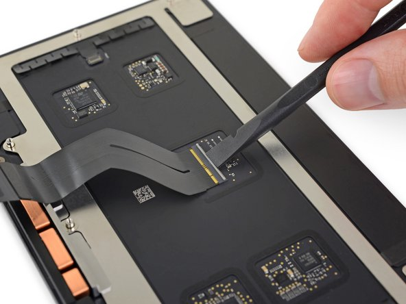 If your new trackpad didn't come with a ribbon cable, use the following three steps to remove and transfer the old ribbon cable to the new trackpad.