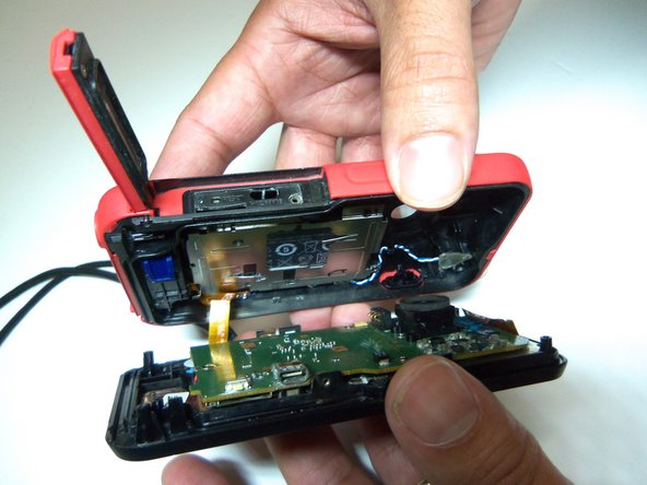Do not pry apart the device too hard. There is a wire that attaches the front case with the rear case.