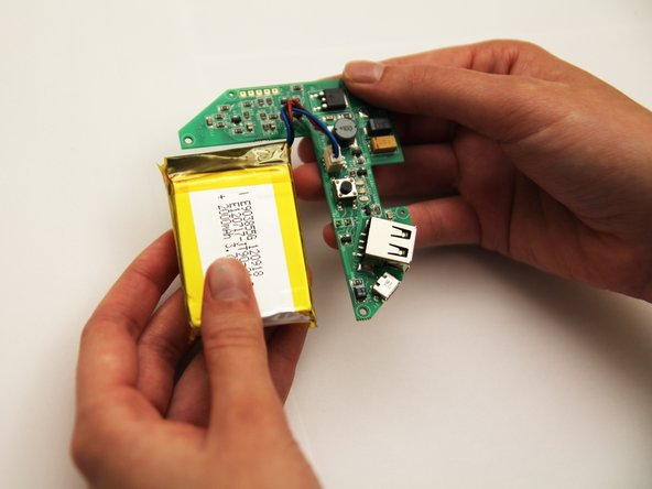 Remove the circuit board and the battery from the plastic casing.