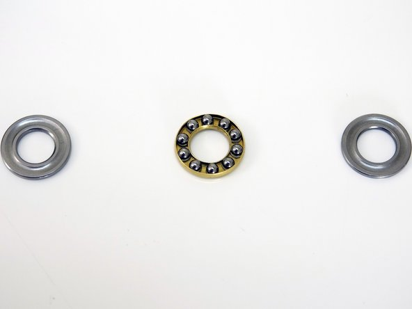 The other three washers make up the bearing assembly on the innermost ring of the wheel.