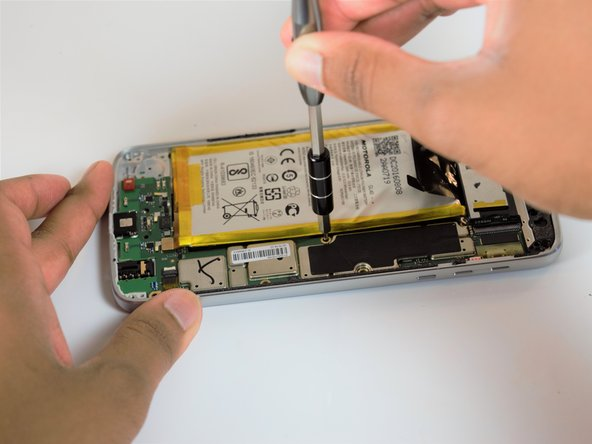 Lift the motherboard up and out of the frame of the phone.