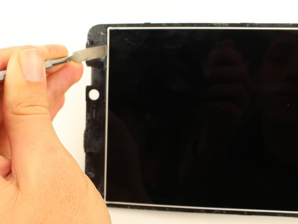Use the metal spudger to get between the device and the internal screen.