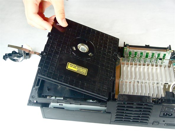 Image 2/2: Lift and remove the lid from the optical disc drive.