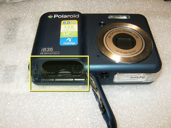 remove the batteries, the memory card as well as the carrying strip (if so equipped).