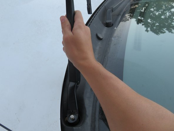 Pull it towards you, so that the wiper arm is extended in the upward position.
