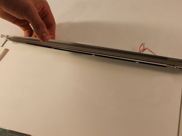 Once all of the latches are unhooked, genitally pull the metal case up to expose the CCFL tube.