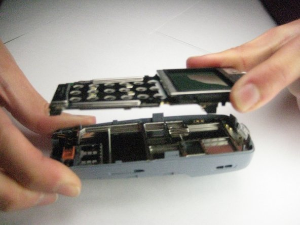 To remove the motherboard, lift it up and off the phone.