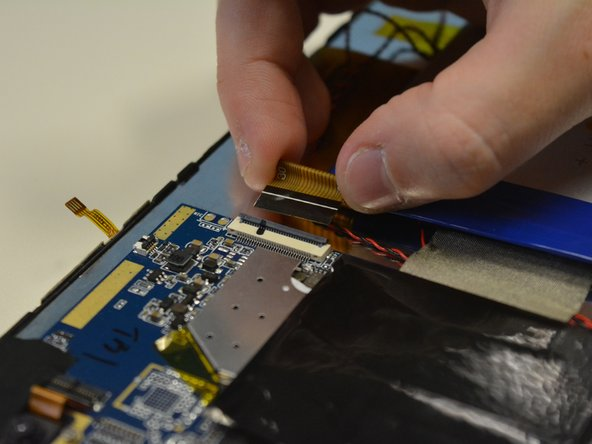 Then detach each of the three tabs from the LCD screen.