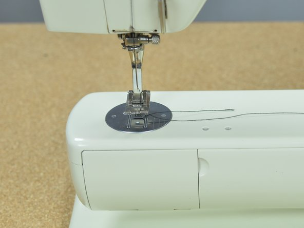 Only turn the balance wheel in the direction that advances the machine. Usually, this means turning the wheel towards you. Turning the wheel in the opposite direction can ruin the tension on the sewing machine, causing it to jam. See your sewing machine manual for instructions specific to your machine.