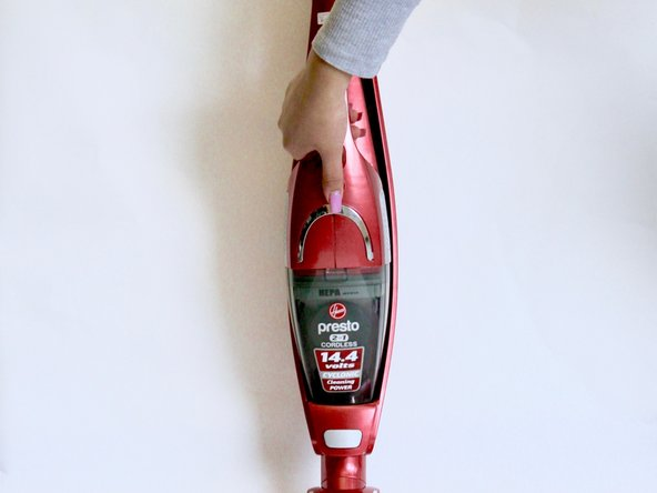 Using your hands, gently pull the hand vacuum away from the stick vacuum to detach.