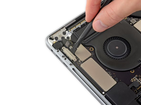 Disconnect the left-side Thunderbolt flex cable by prying it straight up from the logic board.