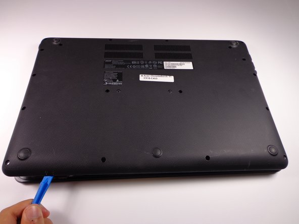Remove the back cover by carefully prying each side with an iFixit Opening Tool.