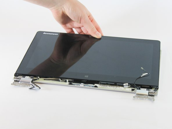 Remove the LCD by carefully pulling away from the hinges and upwards.