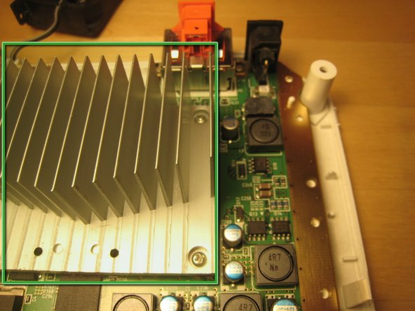 Image 3/3: We opted not to remove the heat sink from the logic board, but it certainly could be removed.