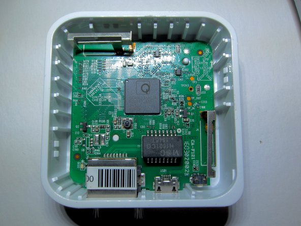 Image 1/2: A spudger  was used to lift the circuit board out of the case.