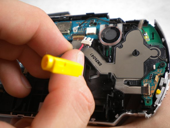Image 1/1: Remove the power jack.