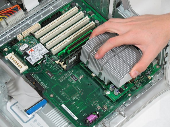 Pull the heat sink up and off of the CPU.