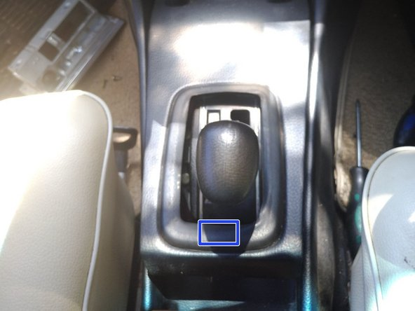 Image 1/3: There is a simple metal trim clip holding the rear of the centre-console trim panel down (marked by a yellow box in photo 2)