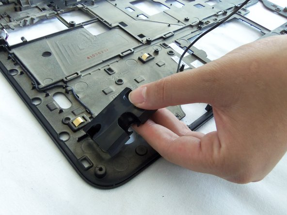 Gently lift and remove the left side speaker from its housing.