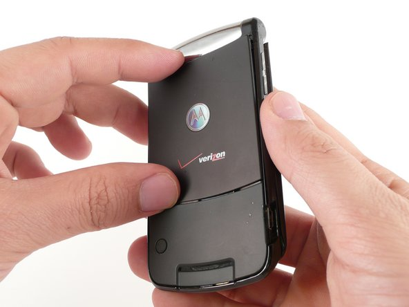 Pinch the top and bottom edges of the panel and pull it away from the RAZR2.
