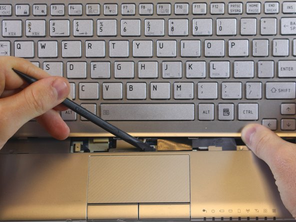 Image 2/2: The cable will slide out on its own when it is properly released.