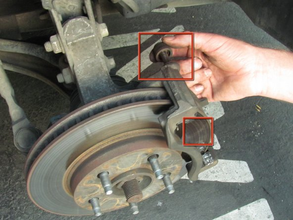 "Image 1/3: If needed,  apply ""Brake Lubricant"" to the two caliper pins. This fights corrosion buildup and allows the pins to slide off more smoothly."