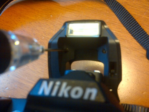 Image 1/1: Note:  The screws are angled slightly toward the outside of the flash unit.