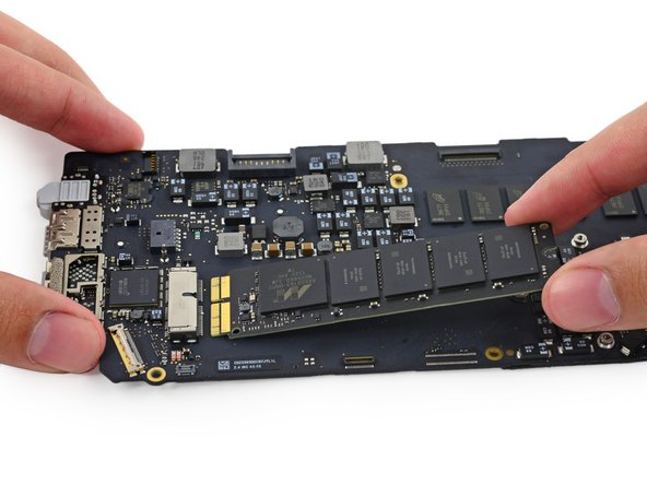 Lift the free end of the SSD up slightly and pull it straight out of its socket on the logic board.