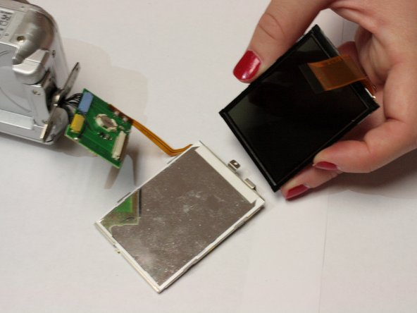 Use a spudger to gently remove the LCD screen from the metal backing plate