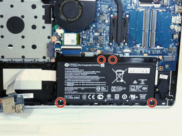 Use a PH000 screwdriver to unscrew the four 3.5mm Philips head screws located on the battery.