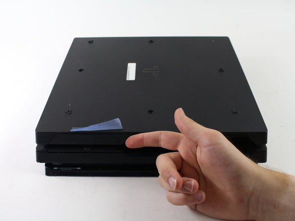 Use your finger to pull and snap off the plastic cover over the hard drive.