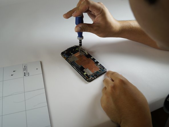 Image 3/3: Some screws are hidden by tape so remove the tape and check for screws.